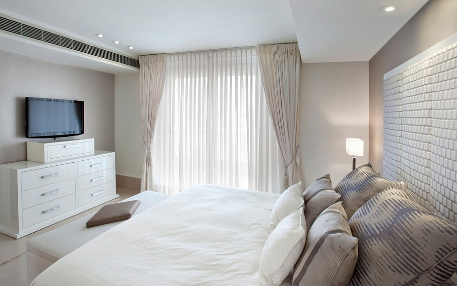 Lovely white sheer curtains allow in ample light