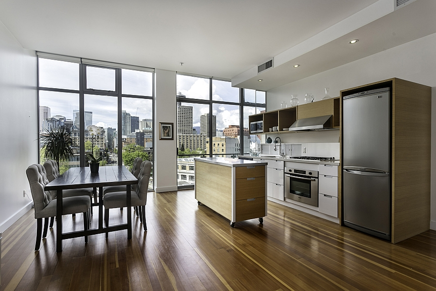 Lovely wooden floors and the smart kitchen island on wheels lend inviting warmth to the space