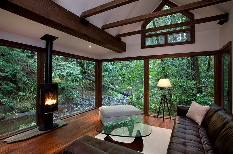 Many shades of nature offer the perfect backdrop for this amazing living room with glass walls