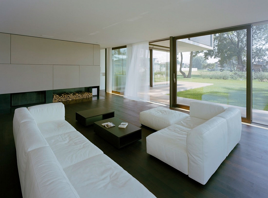 Minimal living area with plush white couch and connectivity with the outdoors