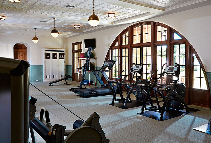 Modern home gym with the Hicks Pendants and stylish recessed lighting