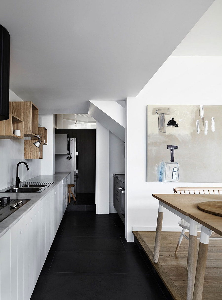 Modern kitchen in white with open wooden shelves and cabinets in white