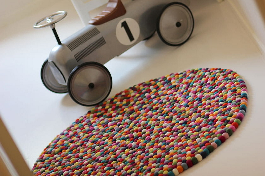 Multi-colored felt ball rug for the playful interior