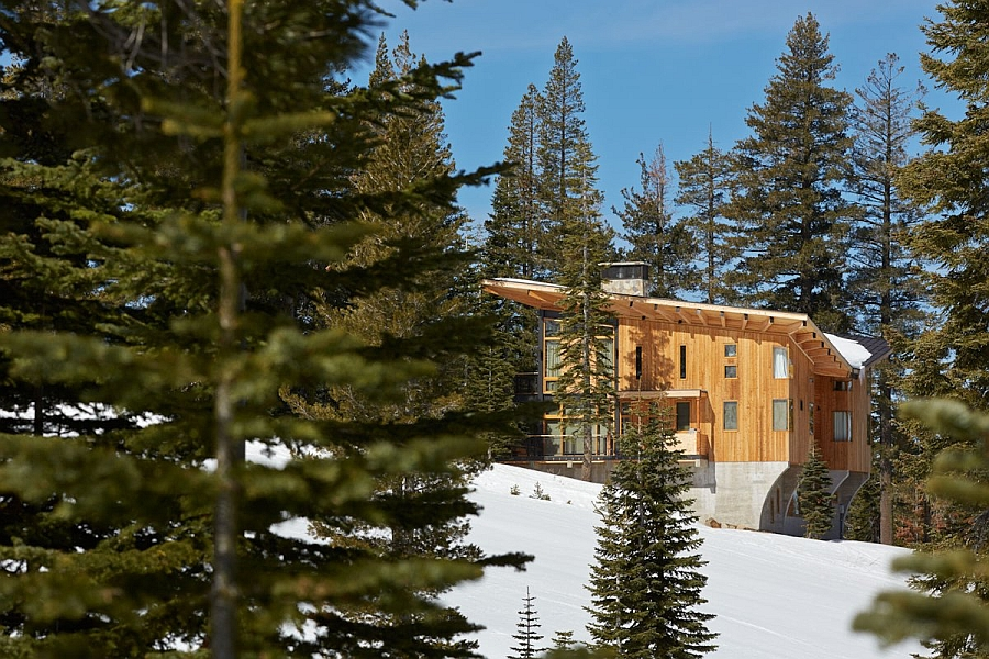 Natural wood and concrete exterior of the Corw's Nest stands out in the snow-covered backdrop