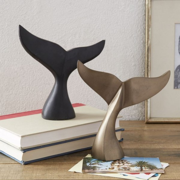 Nautical whale tail sculptures