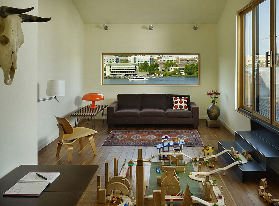 Nesso lamp in bubbly orange along with the Eames Chair in the family room