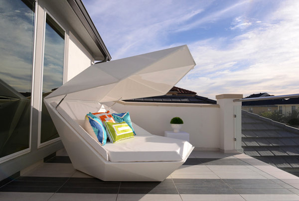 Outdoor lounger with eye-catching pillows