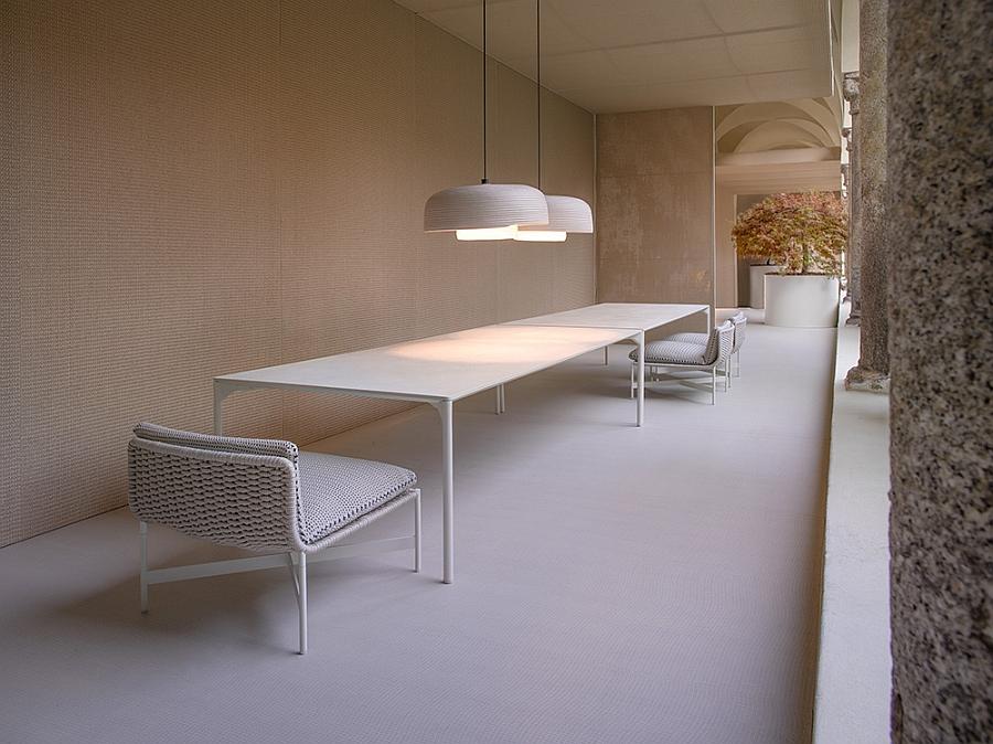 Pendant light and the decor create a beautiful outdoor dining area