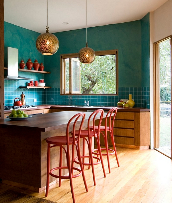 Pendant lights from West Elm steal the show in this eclectic and colorful kitchen