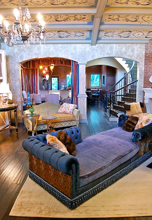 Plush couch in purple steals the show in this Bohemian living room