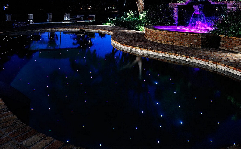 Pool and spa area that mimics the starry night sky using LED lights