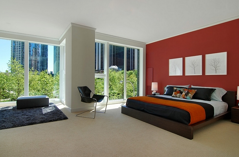 Red accent wall in the bedroom looks classy and elegant