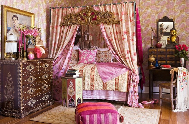 Romantic bedroom in bohemian style is draped in beautiful pink hues