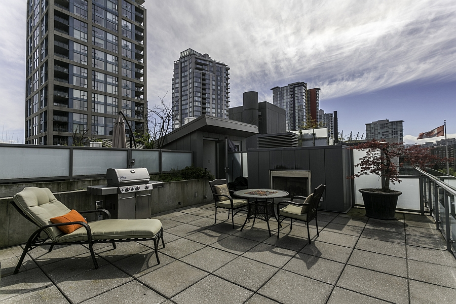 Rooftop deck complete with an outdoor kitchen, lounge and stunning views of Vancouver