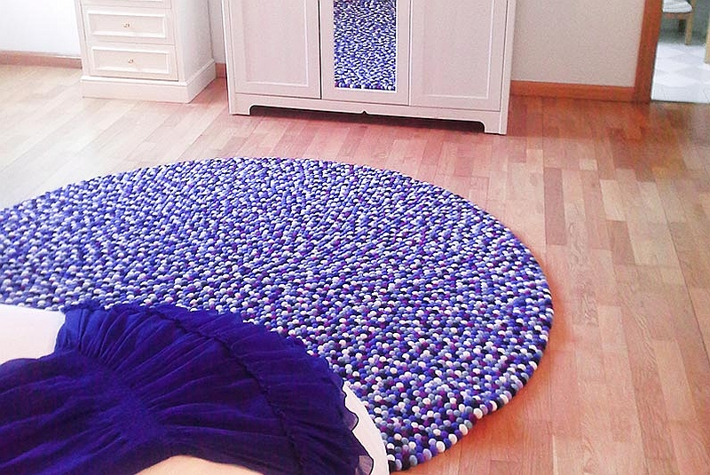 Round purple and white felt ball rug
