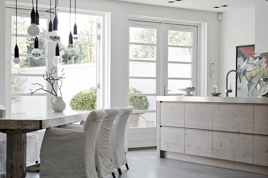 Rustic kitchen in white with a hint of sparkling stainless steel