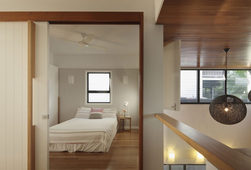 Serene and simple bedroom borrows from the cottage style