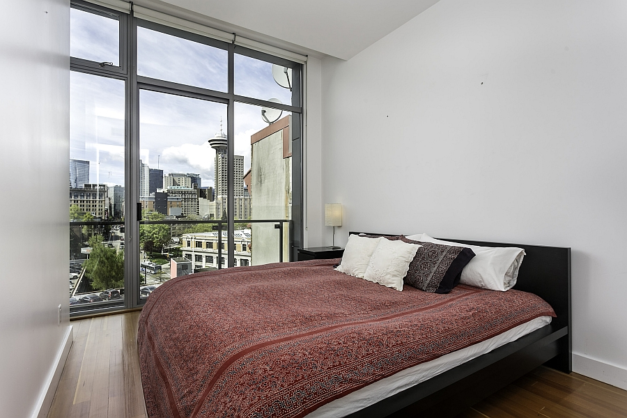 Serene bedroom with unabated views of the Vancouver skyline