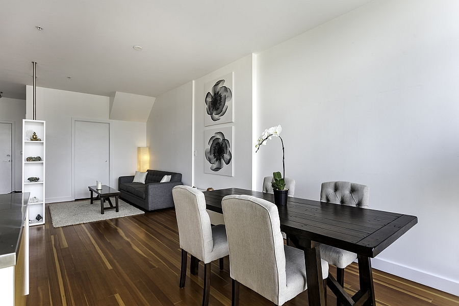 Simple and elegant dining area with a wooden table and plush modern seating