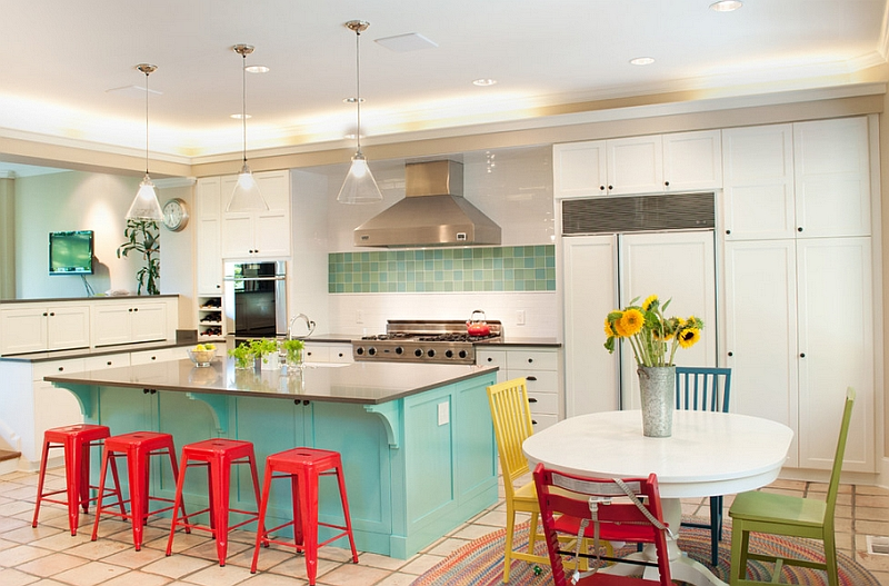 Simple red additions enliven the kitchen draped in blue and white