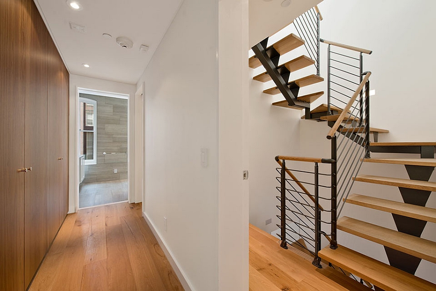 Sleek and space-conscious staircase acts as the backbone of the NYC family house