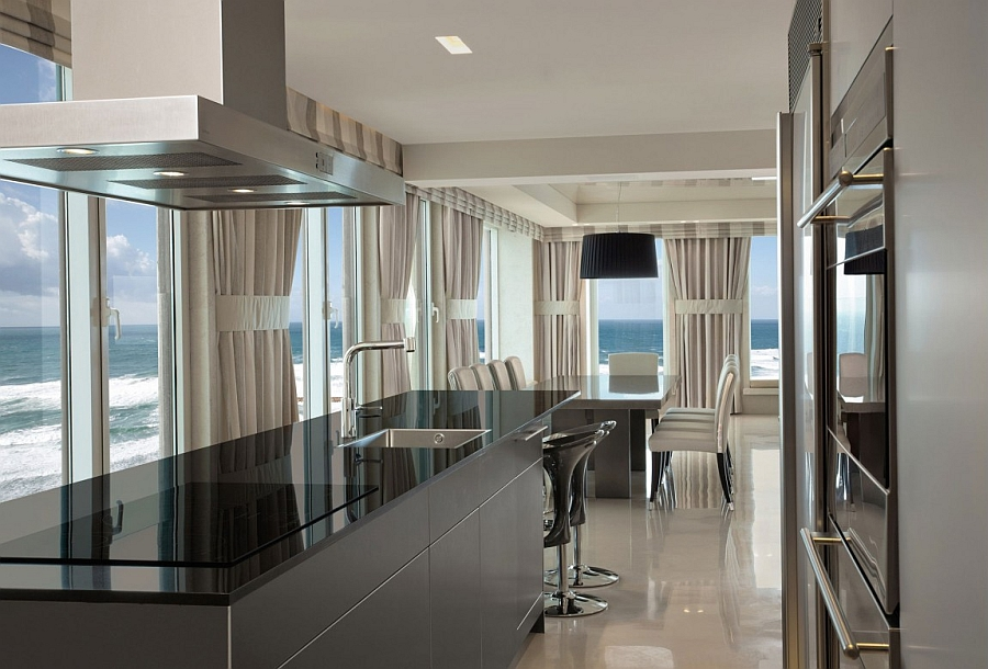 Sleek kitchen in black with state of the art appliances and mesmerizing ocean views