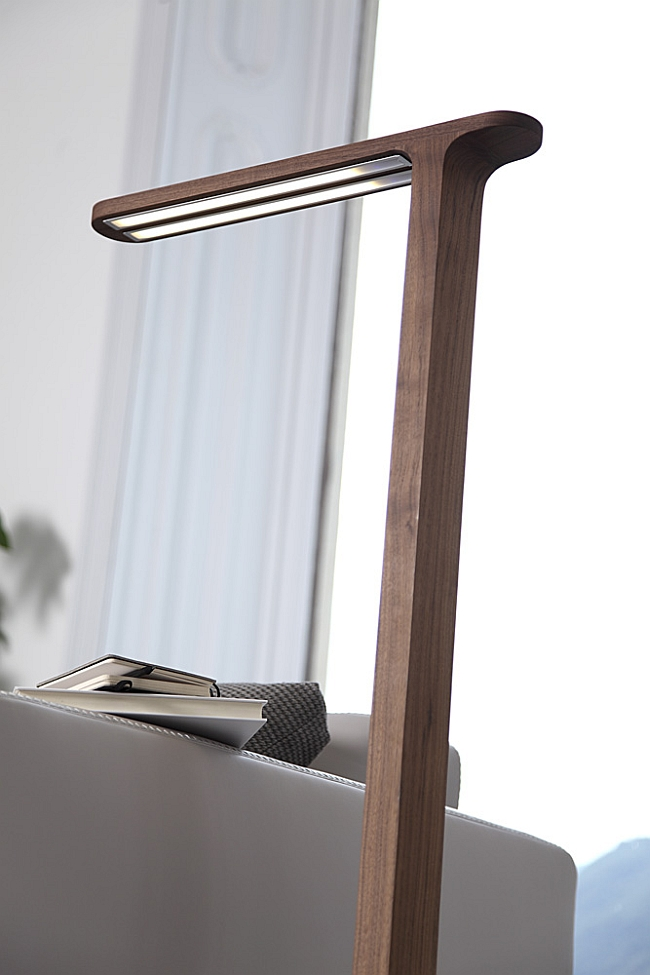 Slim canaletta walnut body of the futuristic floor lamp