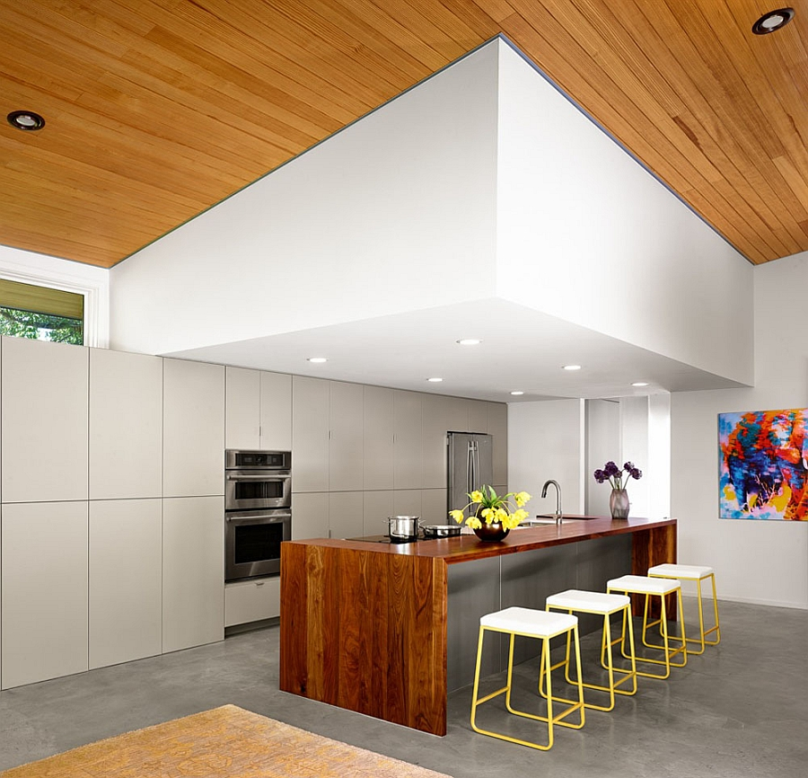 Smart contemporary kitchen with a spacious island and colorful bar stools