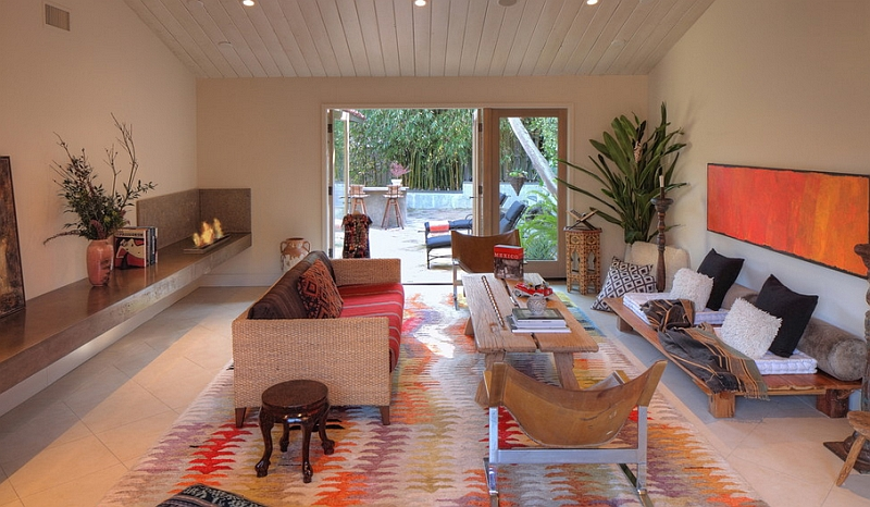 Smart living area with a colorful rug, plush textures and a Bohemian-Mediterranean style