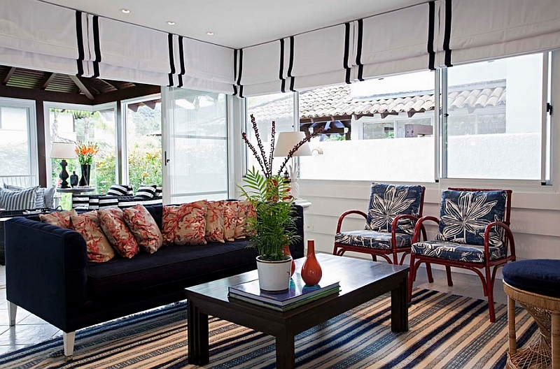 Smart use of roman shades throughout the beach style living room