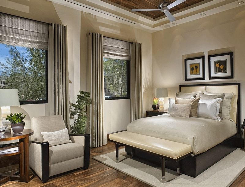 Soft artificial lighting gives this bedroom a lavish look