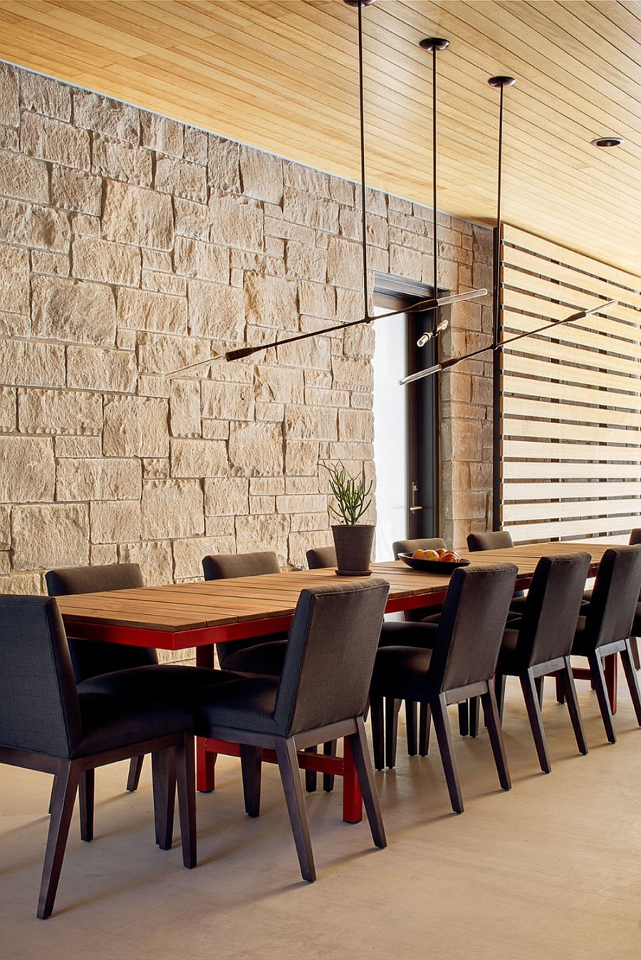 Spacious dining area with ample natural ventilation and lovely pendant lightin
