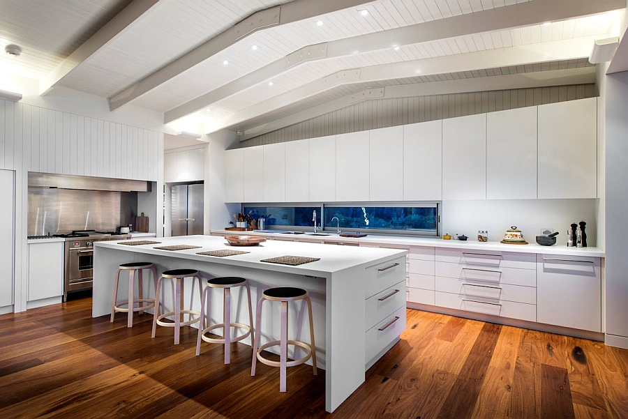 Spacious modern kitchen in white with an elegant serving area
