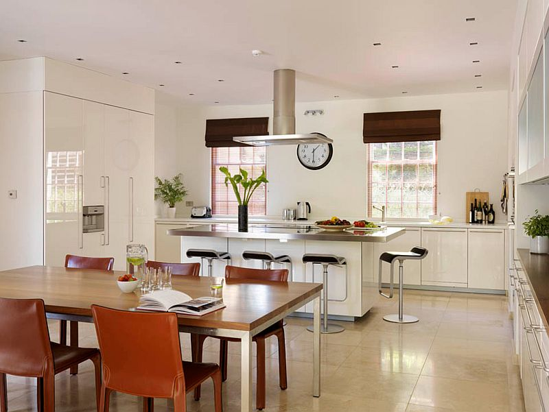 Stainless steel kitchen island with ample seating around it