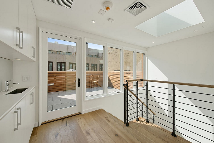 Staircase landing space is utilized to the hilt with smart additons