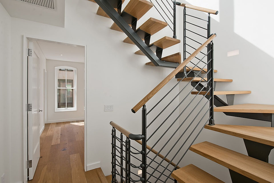 Strategically placed staircase adds to the visual height of the rooms