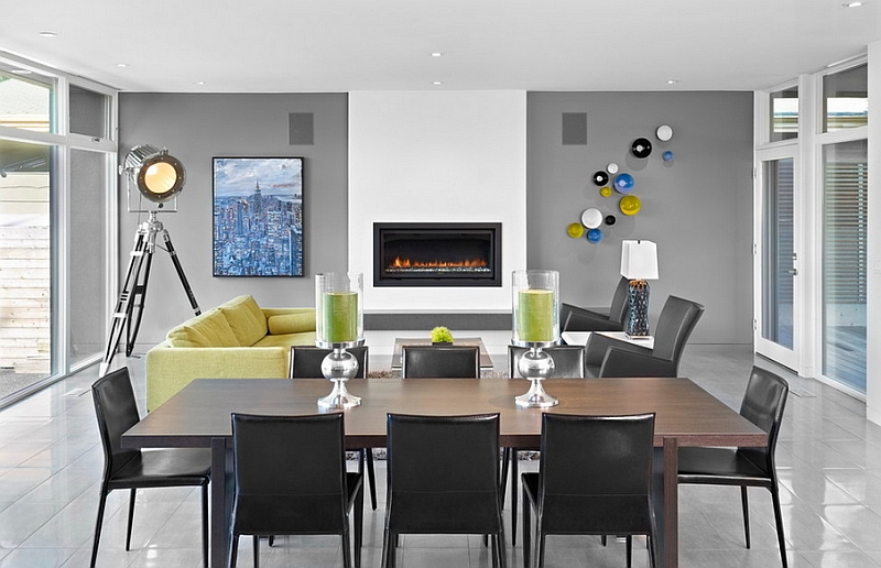 Stunning contemporary dining space with a photographer's lamp standing tall in the backdrop