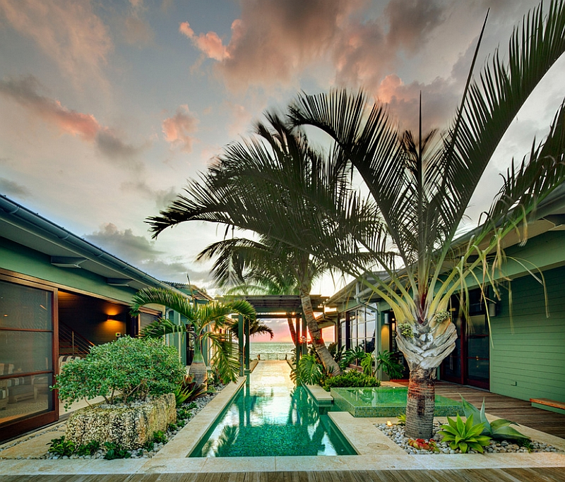 Stunning glass bottom pool and a tropical vibe give the pool deck an exotic appeal