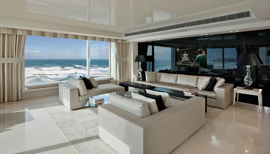 Stunning living room of contemporary residence in Tel Aviv with a black reflective wall Dramatic Tel Aviv Apartment Brings Together Sand, Sea And Sensational Views