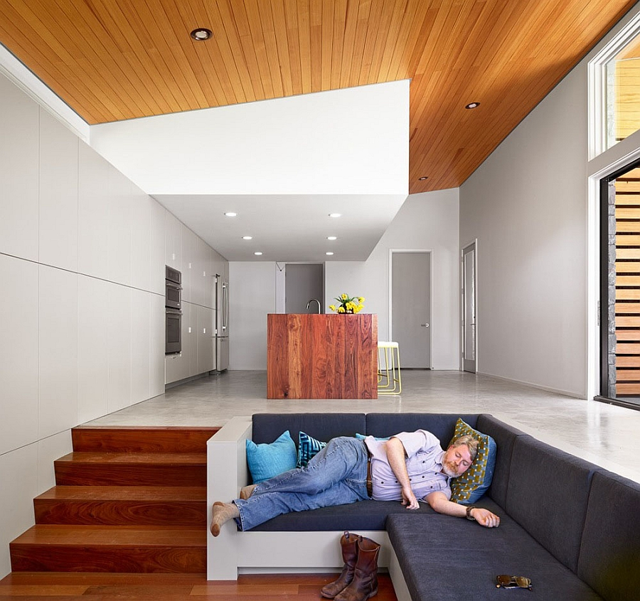 Sunken living space with a cozy couch allows you to relax in peace