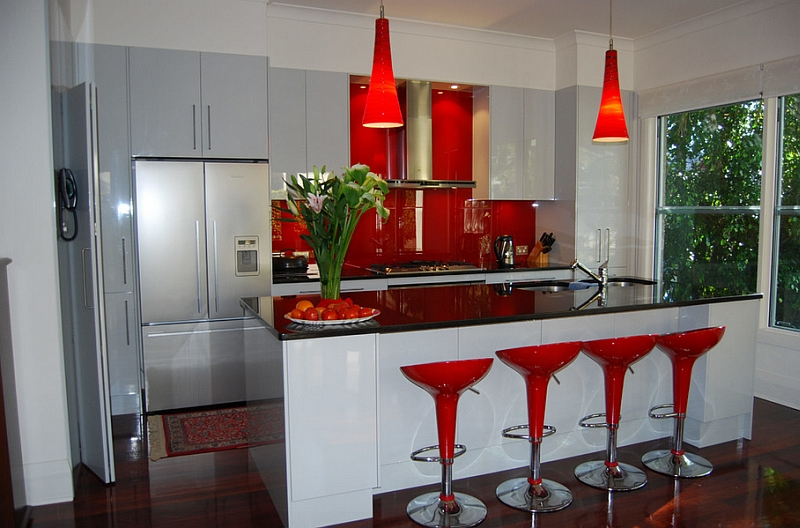 The Bombo bar stools, backsplash and pendants bring bright red to this kitchen