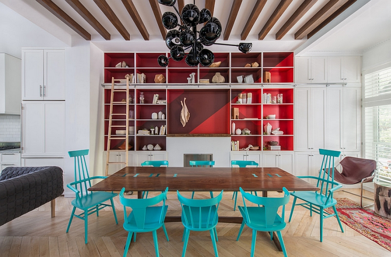 The turquoise gives the room a playful appeal even as the red gives it a grounded focal point