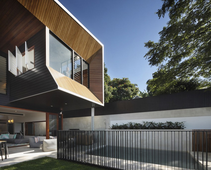 Top level crafted in wood and glass adds to the drama of the house