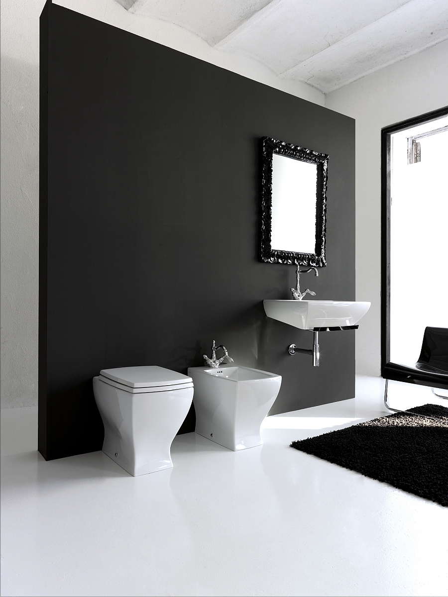 Trendy black and white bathroom with sanitaryware that complements the look