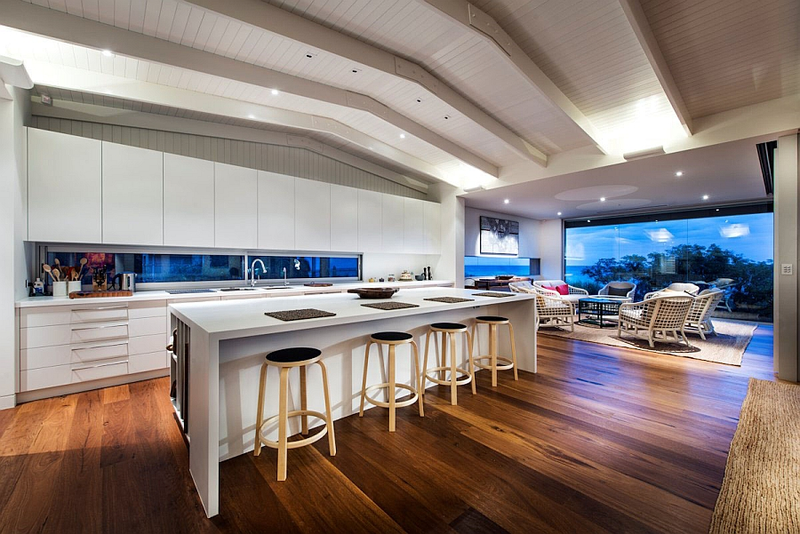 Trendy kitchen in white with a casual beach style