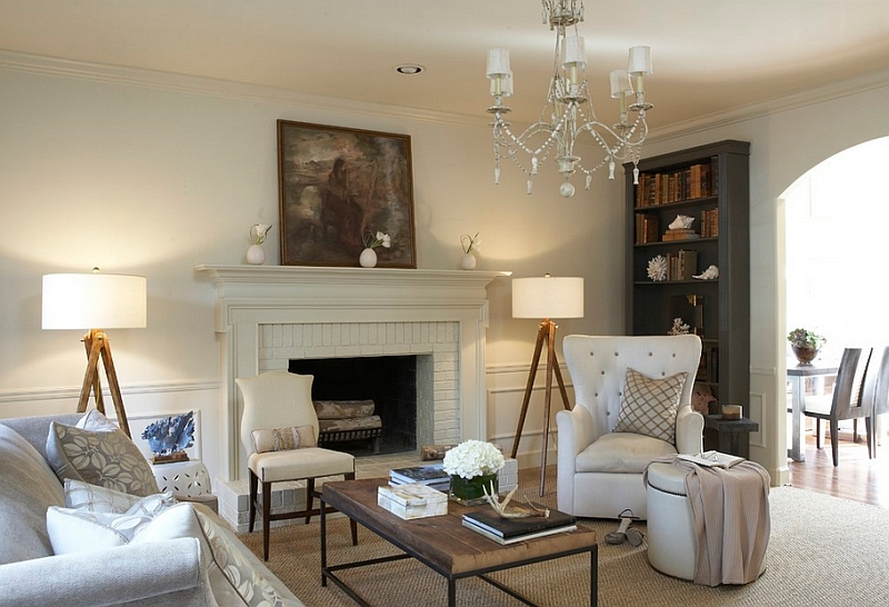 Twin Tripod Floor Lamps by Sandy Chapman grab the attention in this transitional living space