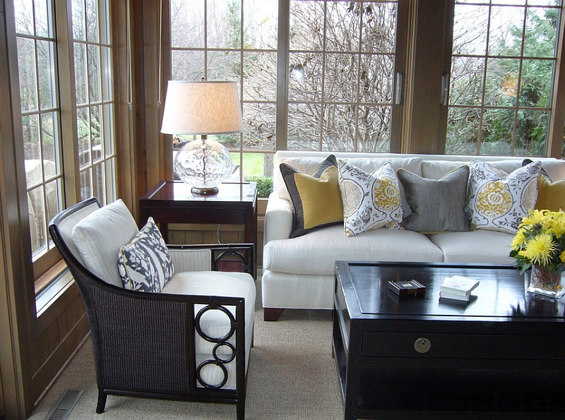 Use throw pillows to bring in the gray and yellow color scheme