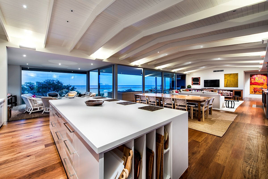 Vaulted ceiling and exposed wooden beams add to the beach style of the house