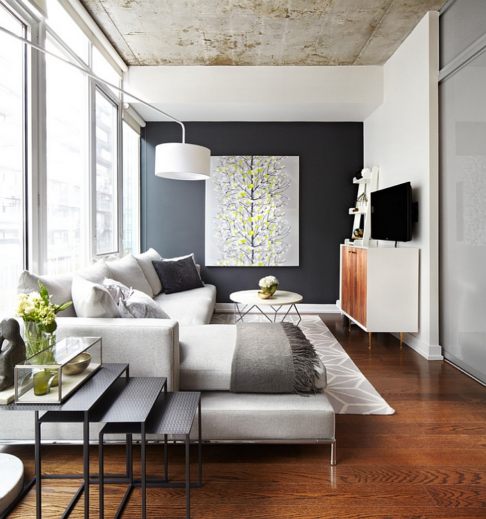 Warm textiles in grey and beautiful wall art standout in this refreshing living room