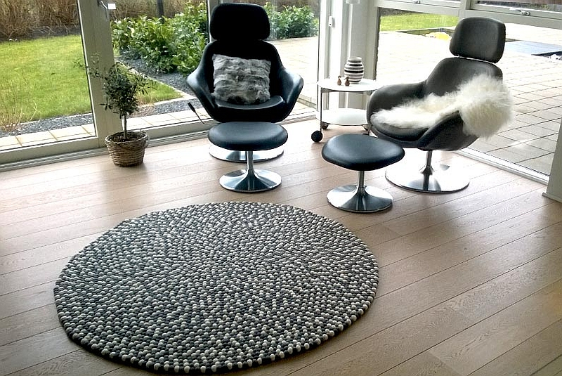 White and grey felt ball rug the urban patio